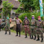 KOKAM Blimbingrejo Bantu TNI-POLRI Amankan Penyambutan Warga Yang Terbebas Dari Covid -19